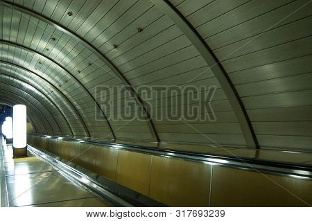 Moscow Metro, Escalator, Rhythm Of Repeating Design Elements And Lamps. Silence, Peace, Desolation,