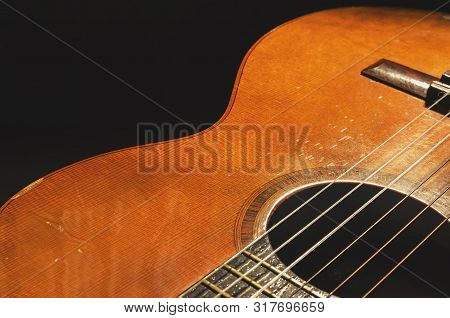 Shapes And Lines Of An Old Acoustic Guitar, The Body Curves, Sound Hole, Frets And Old Rusty Nylon S