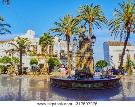 Vejer De La Frontera, Spain - June 26, 2019. Detail Of The Tiled Fountain Of The Plaza De Espana Squ