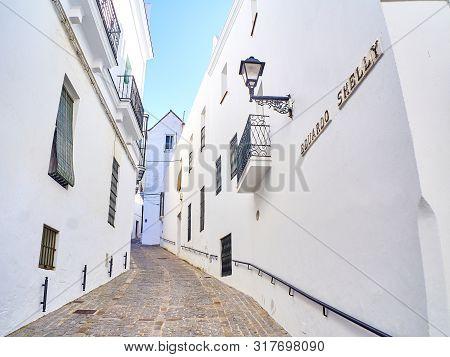 A Typical Street Of Whitewashed Walls Of Vejer De La Frontera Downtown. Eduardo Shelly Street. Cadiz