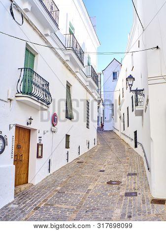 Vejer De La Frontera, Spain - June 26, 2019. A Typical Street Of Whitewashed Walls Of Vejer De La Fr