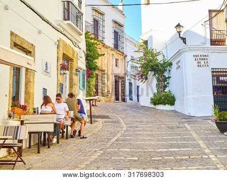 Vejer De La Frontera, Spain - June 26, 2019. A Typical Street Of Whitewashed Walls In Vejer De La Fr