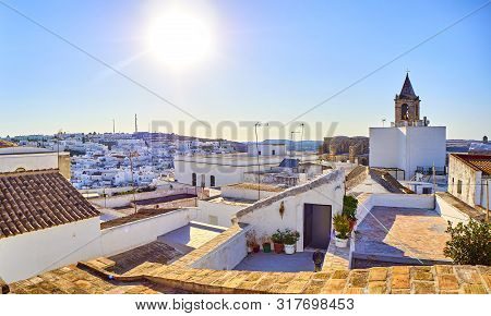 Rooftops View Of Vejer De La Frontera Downtown With The Bell Tower Of The Divino Salvador Church In