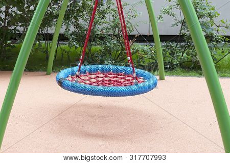 Children's Playground With Swings. Rope Circle Blue On A Swing. Children's Entertainment.