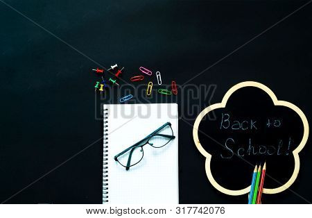 Back To School Over Chalkboard Background. School Supplies On Black Background.close-up, Copy Space