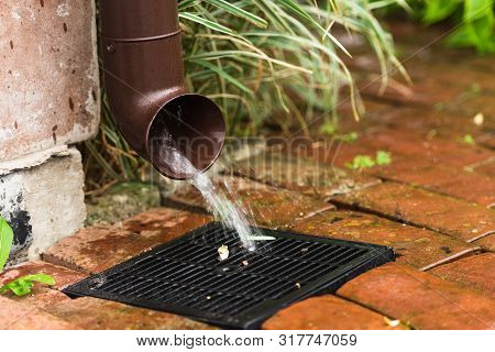 Storm water drain. Rainwater drainage in a private house. poster