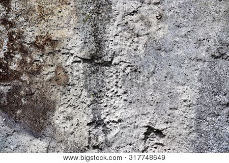 Close Up View On Detailed Concrete Walls With Paint And Cracks In High Resolution