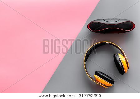 Wireless Speaker And Headphones As Music Gadgets On Pink And Gray Background Top View Mockup