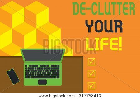 Conceptual hand writing showing De Clutter Your Life. Business photo showcasing remove unnecessary items from untidy or overcrowded places Office working place laptop lying wooden desk smartphone. poster