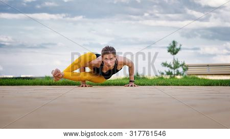 Woman Practicing Yoga Blue Sky Background. Reached Peace Of Mind. Meditation And Yoga Concept. Yoga