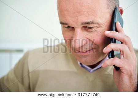 Close-up Image Of Mature Caucasian Entrepreneur Answering Phone Call From Client Or Business Partner