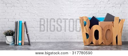 Book Shelf With Books In Wooden Box On Brick Wall Texture Background.