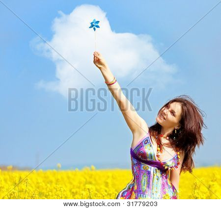 beautiful young woman on rapeseed (canola) field