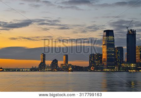 A Night View Of Jersey City From Battery Park.