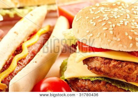 Couple hotdog,hamburger, sandwich and ingredients. Fast food composition.