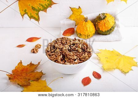 Autumn Composition With Walnuts, Pumpkins  And Colorful Fall Leaves On White Background. Copy Space.