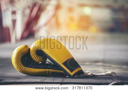 Boxing Leather Mitt Glove Placed On Canvas Of Ring In Camp Of Training Boxer.equipments For Protecti