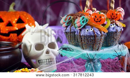 Halloween Candyland Drip Cake Style Cupcakes In Party Table Setting.