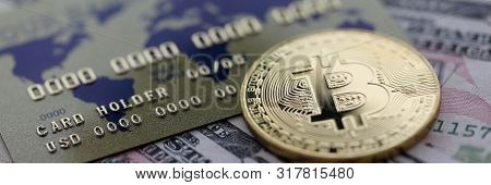 Gold Coin Bitcoin Closeup Lie On Table With Dollar Paper And Credit Card Aganist Table Background. C