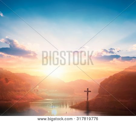 Jesus Christ Cross Concept: Crucifixion Of Jesus Christ Cross At Sunset Background