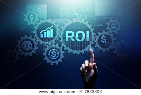 Roi Return On Investment Reading Revenue Business Concept On Virtual Screen.