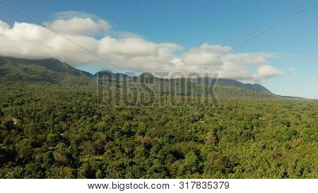 Mountains Covered Rainforest, Trees And Blue Sky With Clouds, Aerial View. Camiguin, Philippines. Mo