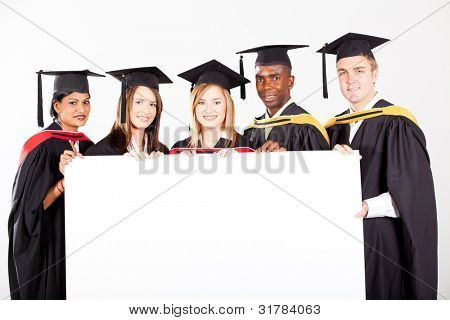 group of graduates with white board