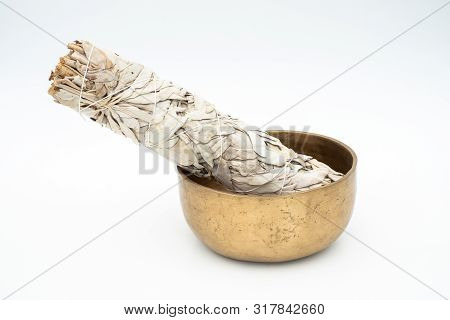 Flat Lay Composition Of Dried White Sage And Ancient Hand Crafted Traditional Tibetan Meditation And
