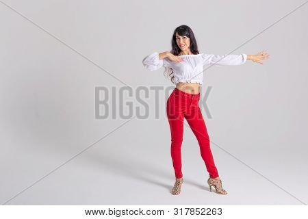 Latin Dance, Contemporary Dance, Bachata Solo And Cha-cha-cha Concept - Portrait Of A Young Woman Sa