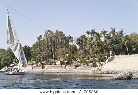 Egyptian sailing boat in front of Botanical garden, Aswan, Egypt.