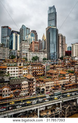 Chongqing China, 6 August 2019 : Vertical Cityscape Of The Skyline Of Chongqing At Dusk With Illumin