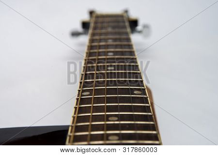 Guitar Fretboard Close-up Top View Of The Neck Of The Guitar And Strings On White Isolated Backgroun