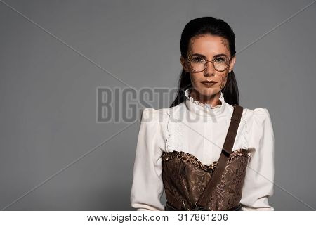 Front View Of Steampunk Woman With Makeup Isolated On Grey