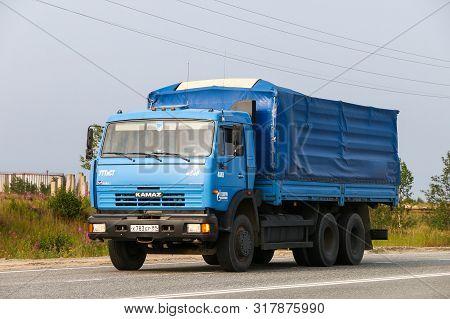 Novyy Urengoy, Russia - July 30, 2019: Blue Flatbed Truck Kamaz 53215 At The Interurban Road.