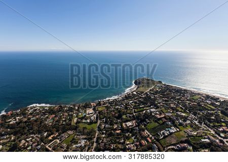 Aerial view of large pacific ocean view homes near Point Dume in Malibu California.