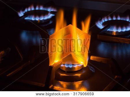 Burning Bill Of Hundred Ukraine Hrivnas On A Gas Burner Flame, Expensive Natural Gas Concept