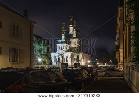 Geneva Street With Parked Cars And Russian Orthodox Church (eglise Russe) With Golden Onion Domes At