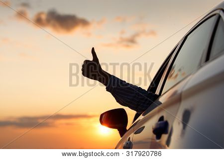 Man Showing Thumbs Up/making Like / Ok Sign With Hand From Car Window With Sunset Sky, Relaxing, Enj