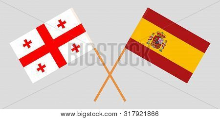 Georgia And Spain. Crossed Georgian And Spanish Flags. Official Colors. Correct Proportion. Vector I