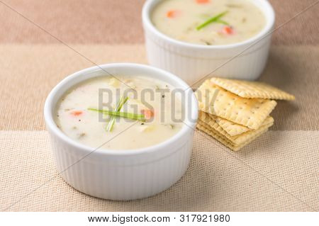 Warm Bowls Of Clam Chowder. Traditionally From The United States, New England Clam Chowder Is A Deli
