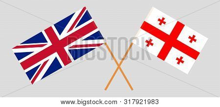 Georgia and the UK. Crossed Georgian and British flags. Official colors. Correct proportion. Vector illustration poster