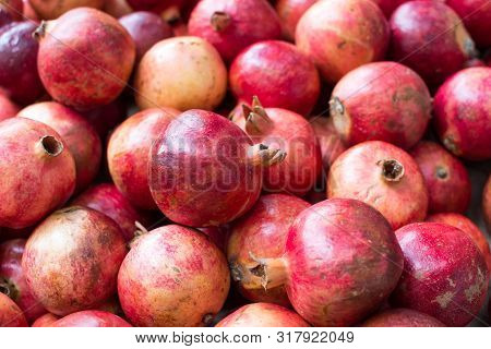 Bunch Of Red Pomegranates At The Market