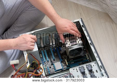 Service Electronics And Computers Concept. Hands Of Technician Is Repairing A Computer. Hardware. Co