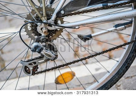 Part of a being in use bycicle close up