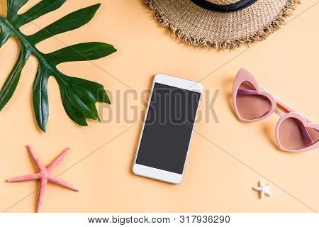 Travel Accessories Items With Smart Phone On Color Background, Summer Vacation Concept