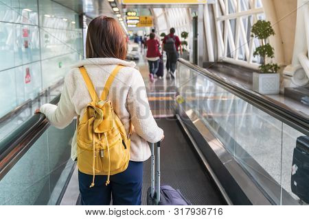 Young Woman Traveler With Baggage And Backpack At The Airport