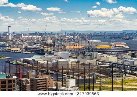 Aerial view kobe cityscape and Port industrial zone in Kobe Hyogo Kansai Japan using for import export shipping and global business background
