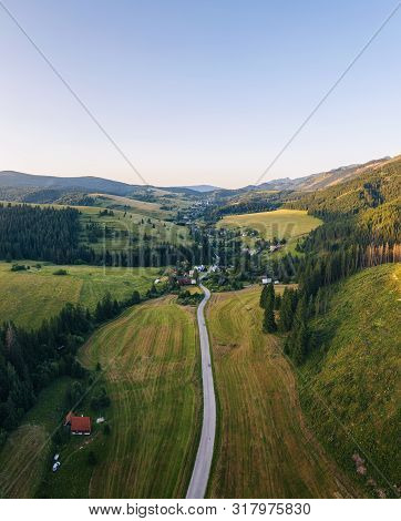 Aerial View Of A Road Going Through Forests And Villages Of The Liptov Region In Slovakia