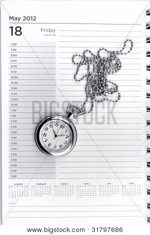 Pocket watch on diary page