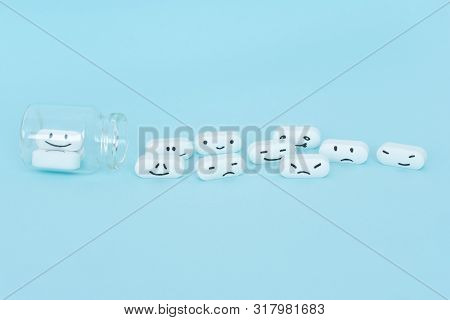 Classical Homeopathy Globules In Shape Of Heart And Vintage Glass Bottles On Blue Background. Altern